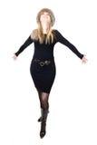 Blonde Russische vrouw die in bonthoed op telepho spreekt Stock Afbeeldingen