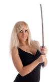 Blonde with a sabre in hands looks at you Stock Photography