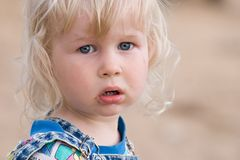 Blonde sad little girl Stock Photos