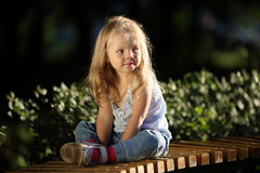Blonde sad little girl Stock Images
