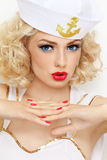 Blonde sailor. Young beautiful girl with blond curly hair and stylish make-up dressed as sailor stock photos