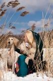 Blonde and saluki Stock Image