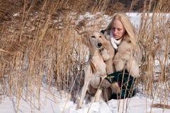 Blonde and saluki Royalty Free Stock Image