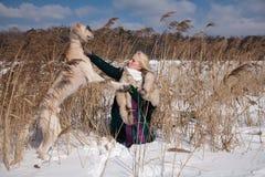 Blonde and saluki Royalty Free Stock Photos