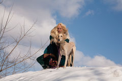 Blonde and saluki Royalty Free Stock Photo