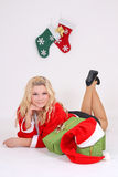 Blonde in santa costume with gift Royalty Free Stock Photos