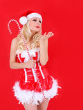 Blonde Santa girl blowing kiss Royalty Free Stock Photos