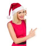 Blonde Santa Girl, die auf ein Plakat zeigt Lizenzfreie Stockbilder