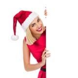 Blonde Santa Girl hinter einem Plakat Stockfotografie