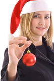 Blonde santa girl holding ornament Royalty Free Stock Photography