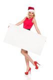 Blonde Santa Girl posing with white placard Stock Photo