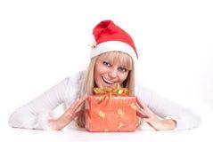 Blonde in santa hat royalty free stock images
