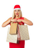 Blonde in a Santa's helper hat holding a shopping bag Royalty Free Stock Image