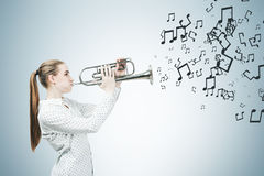 Blonde saxophone player and music notes Stock Photos