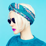 Blonde in scarf. Trendy fashion accessory of the season Royalty Free Stock Image