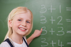 Blonde schoolgirl pointing at something Royalty Free Stock Photos