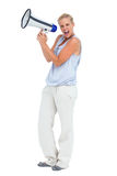 Blonde screaming holding megaphone Royalty Free Stock Photo