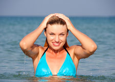 Blonde in the sea Royalty Free Stock Image
