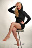 Blonde is seating on chair. Nice young blonde is seating on a chair Stock Image
