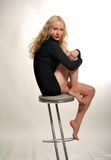 Blonde is seating on chair Royalty Free Stock Photography