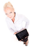 Blonde secretary holding a tablet pc Royalty Free Stock Photos