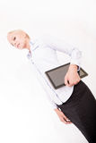 Blonde secretary holding a tablet pc Stock Images
