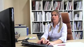 Blonde secretary receiving calls in business company stock video