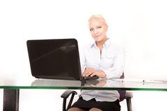 Blonde secretary working on a laptop Royalty Free Stock Photography