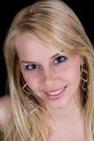 Blonde sensuelle de sourire Photographie stock libre de droits
