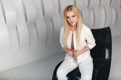 Blonde sexy beautiful girl with long  hair and glamour makeup posing in studio Stock Photos