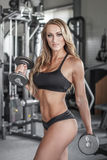 Blonde sexy bodybuilder workout with dumbbells Royalty Free Stock Photo