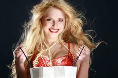 Blonde sexy con il regalo Immagine Stock