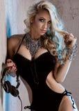 Blonde sexy dj posing. Royalty Free Stock Photography