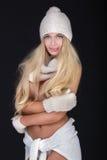 Blonde sexy Frau in der Kappe Stockfotografie
