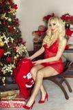 Blonde sexy Frau, Weihnachtszeit Stockfoto