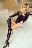 Blonde sexy Frauenaufstellung Stockfotos