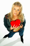 Blonde girl holding a red velvet heart 3 stock image