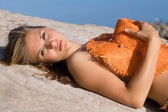 Blonde and girl under the sun royalty free stock image