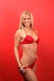 Blonde 'sexy' no biquini vermelho Fotografia de Stock Royalty Free
