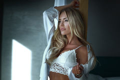 Blonde sexy woman in bedroom Stock Photo