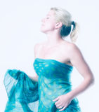 Blonde, sexy woman dancing in a light flooded room Royalty Free Stock Images