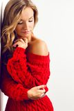 Blonde sexy woman with wearing red dress Royalty Free Stock Photography
