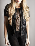Blonde in sheer top and leather jacket Royalty Free Stock Photography