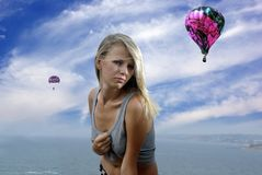 Blonde in a shirt against sky and sea Stock Image