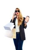 Blonde shopaholic vrouwenzakken en smartphone royalty-vrije stock foto's