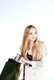 Blonde on shopping  on white Royalty Free Stock Images