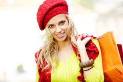 Blonde shopping woman with bags Royalty Free Stock Image
