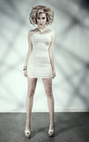 Blonde in a short dress Royalty Free Stock Image