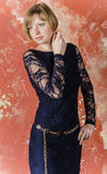 Blonde with short hair in blue overalls with lace sleeves and sandals with high heels Royalty Free Stock Photography