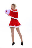 Blonde in a short Santa costume Royalty Free Stock Image